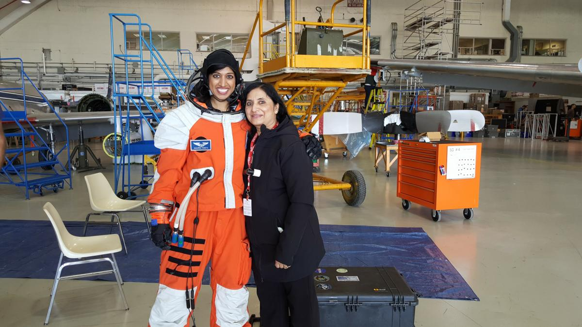 Dr. Shawna Pandya in the Final Frontier Design IVA (intravehicular activity) spacesuit with her mother, Indira Pandya, during the Project PoSSUM 2016 Parabolic Flight campaign