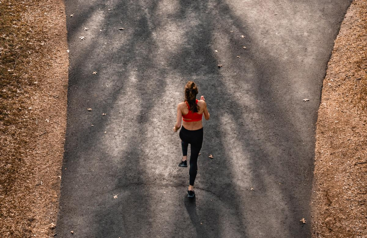 Aerial shot of girl in red top running