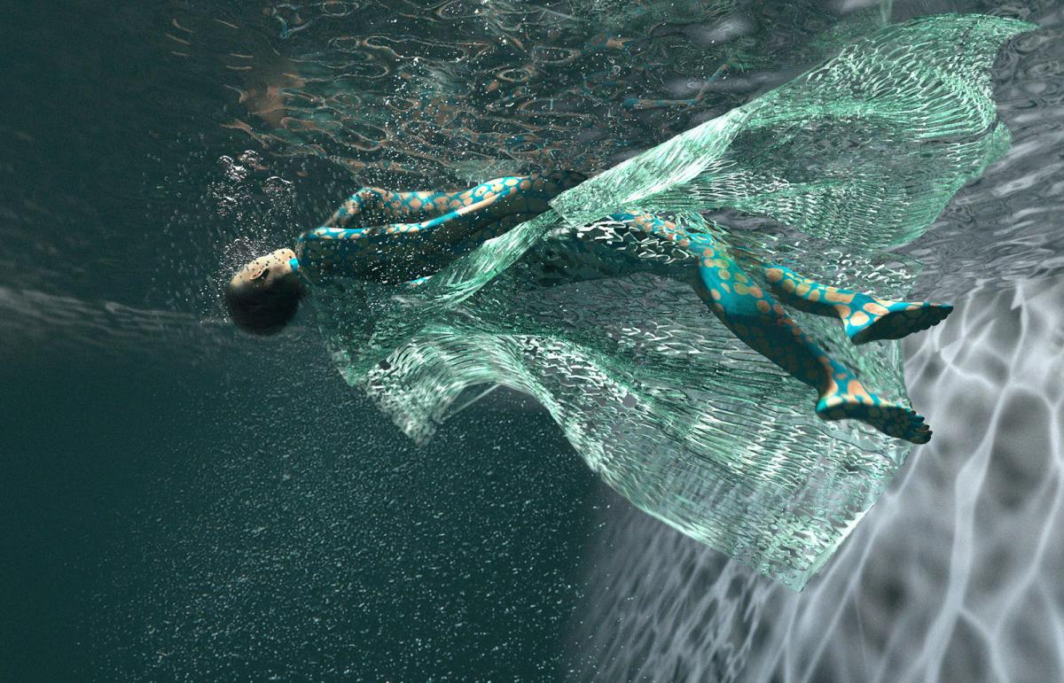 woman wearing a dress made of the ori seri textile floating underwater