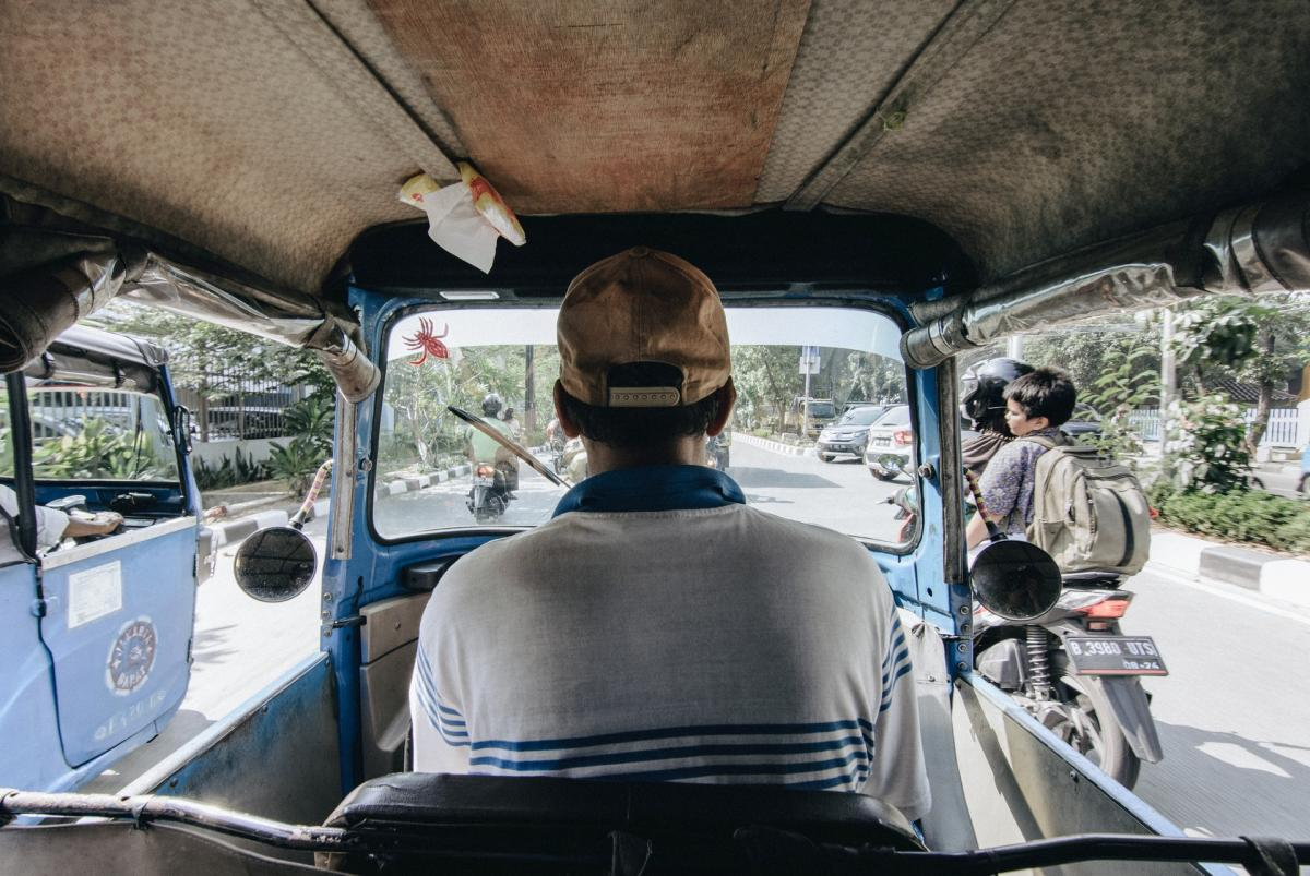 Jakarta city has many modes of transportation for the public. The Bajaj (or auto-rickshaw) is one of them. It is not air-conditioned but at least there's a roof on top and side cover that can be used when it rains. I captured this shot from the inside the