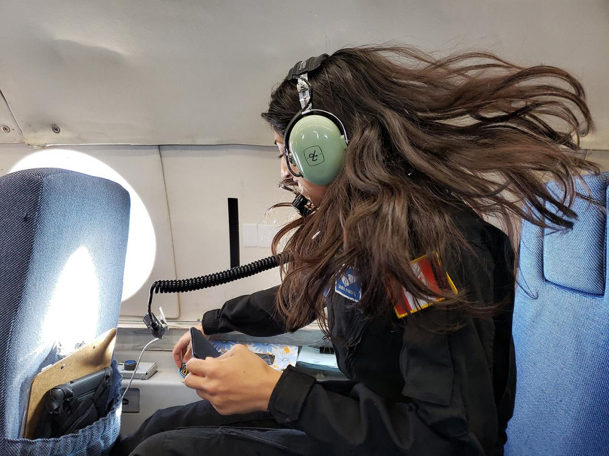 Dr. Shawna Pandya in blue IVA suit tests a next-generation Final Frontier IVA (intravehicular activity) spacesuit in microgravity during the 2018 PoSSUM parabolic flight campaign