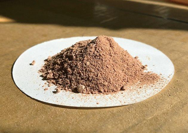 NovoNutrients fish meal - brown powder on a white sheet