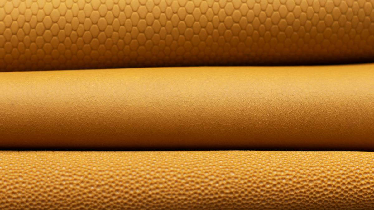 TomTex yellow bioleathers in three different textures