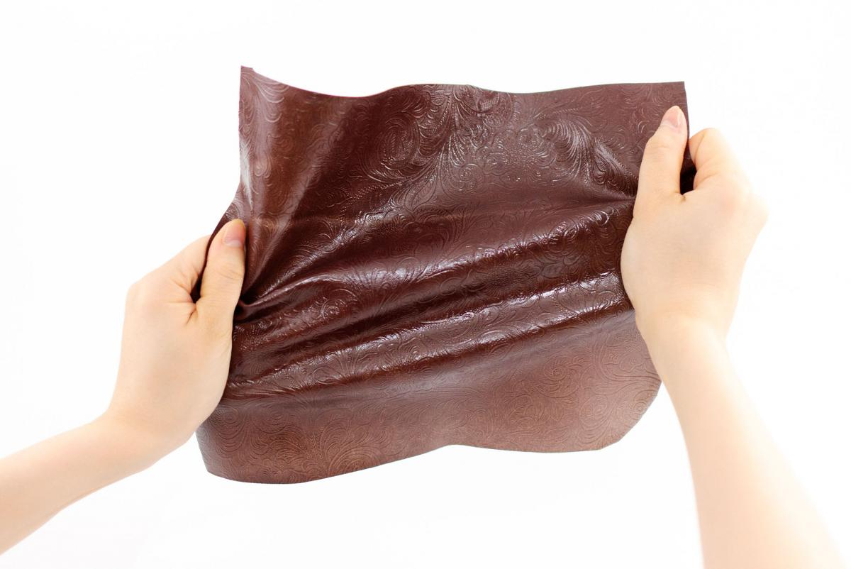 TômTex bioleather being stretched by hands