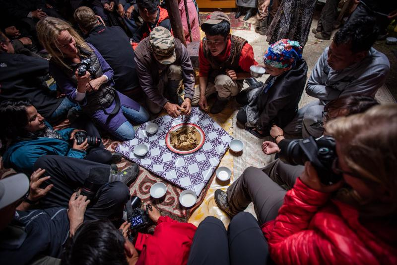 A typical dinner setup. Everyone sits on the ground around a bowl of meat. The fat from the sheep's back is considered a delicacy and is offered to the guests first.