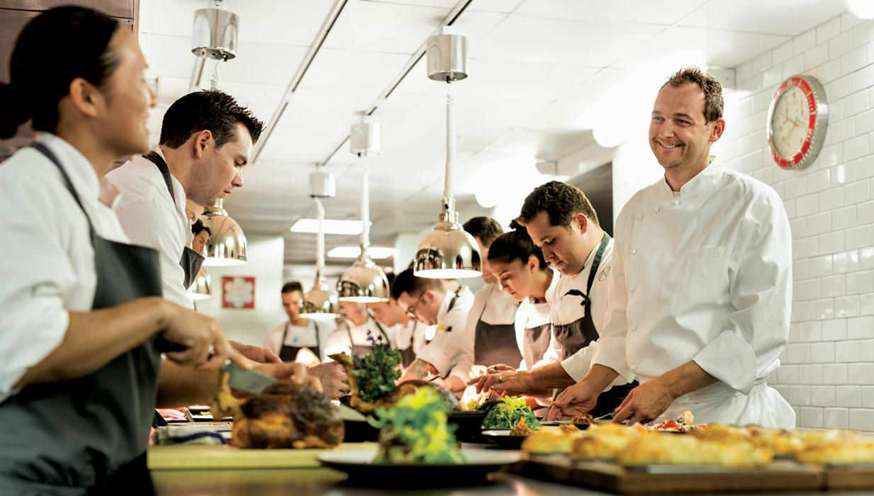 Executive head chef, Daniel Humm, talking with his team of chefs in his kitchen at Eleven Madison Park Restaurant, NYC