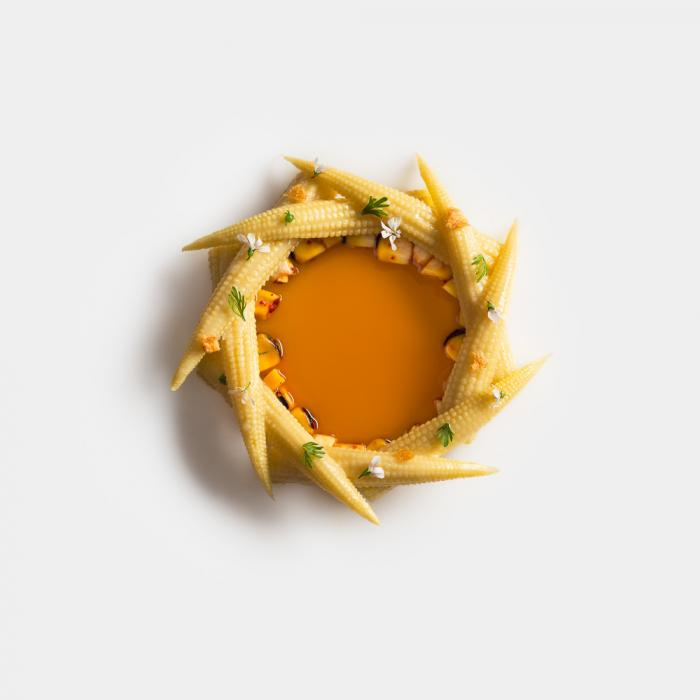 Bowl of corn with lemongrass soup by Daniel Humm at Eleven Madison Park Restaurant, NYC