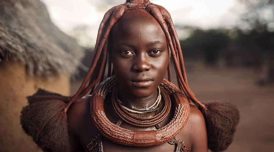 From the time a Himba girl is born, her hairstyle will identify her place in society. Photo by Sean Tucker.