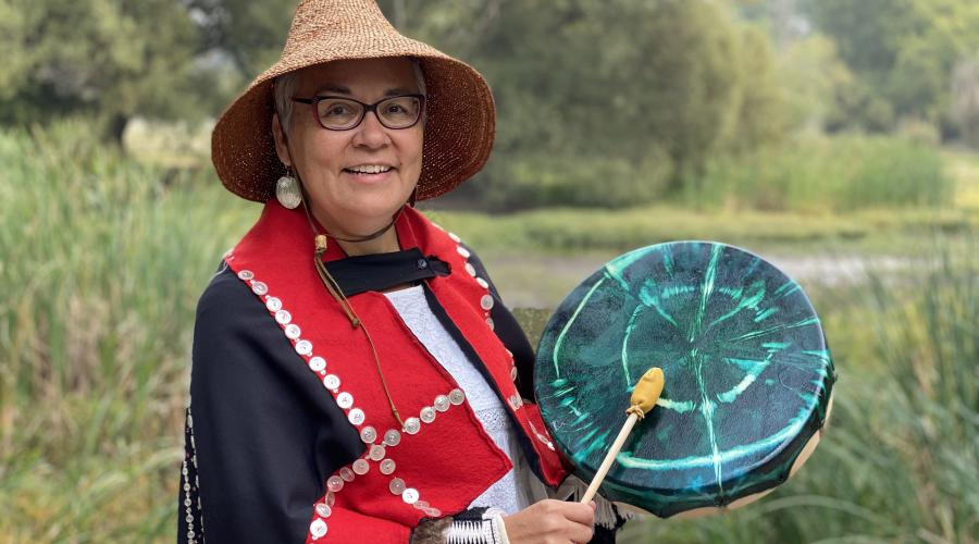 Kung Jaadee holding a traditional drum