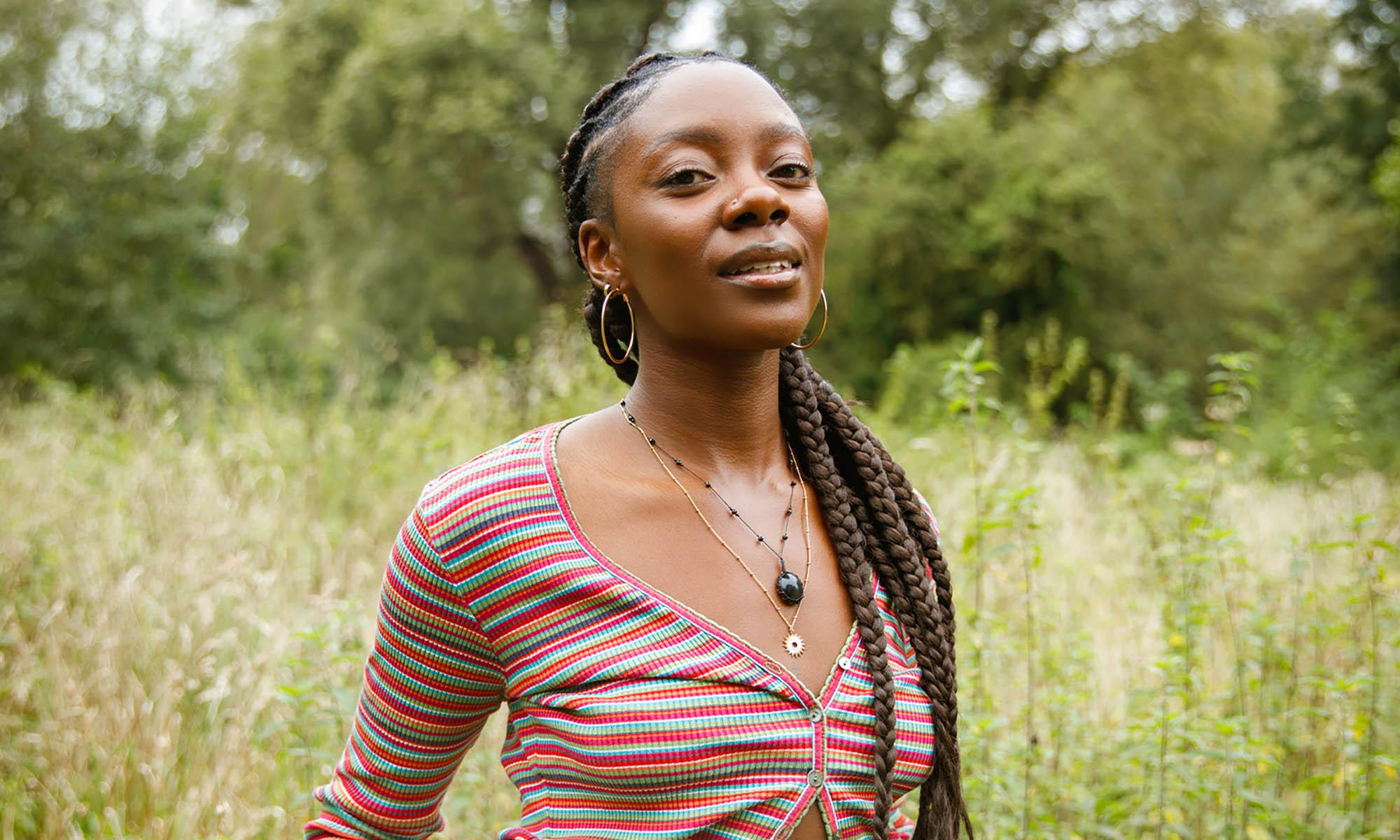 Climate In Colour founder Joycelyn Longdon, greenery in background